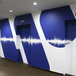 WMG Logo with Sound Waves across Elevators