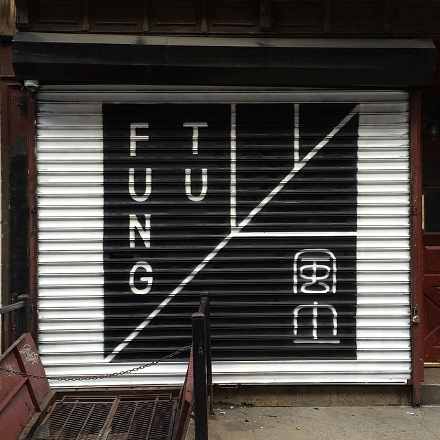 Spray Painted Roll Down Gate Logo