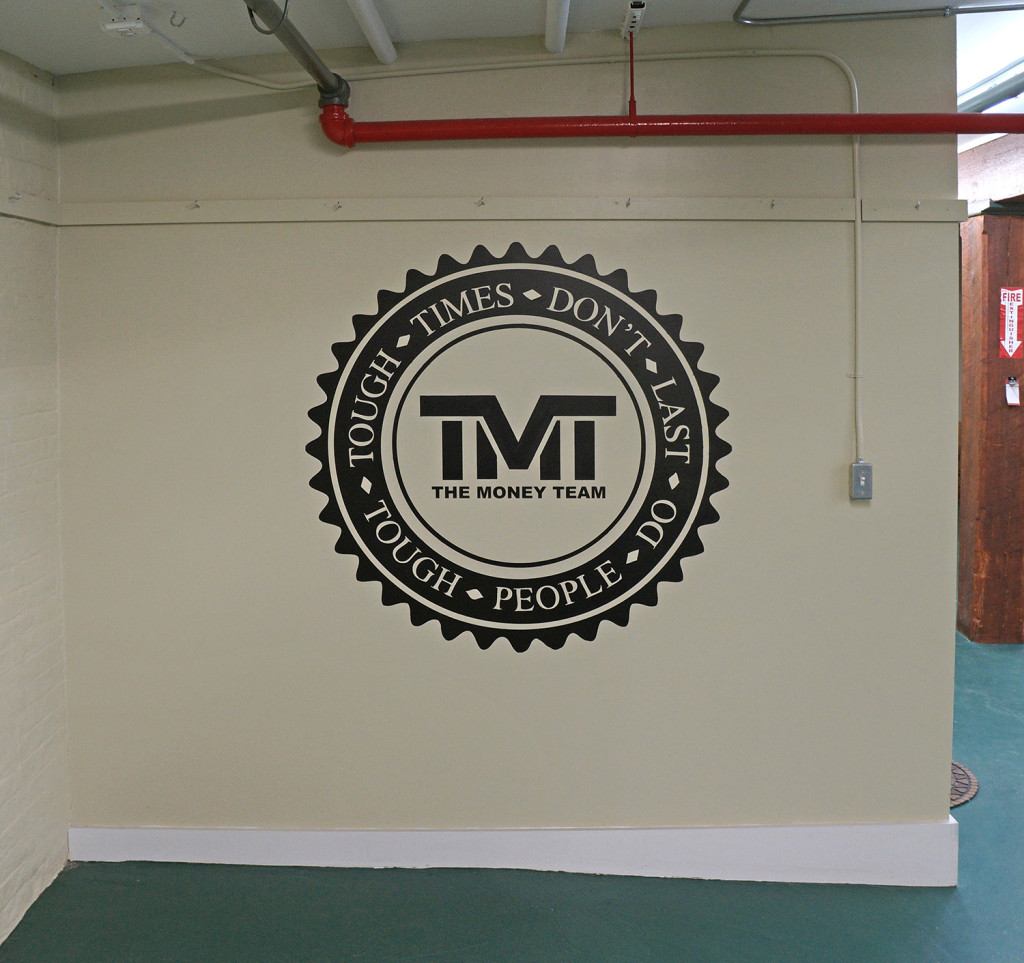 The Money Team Logo in Warehouse