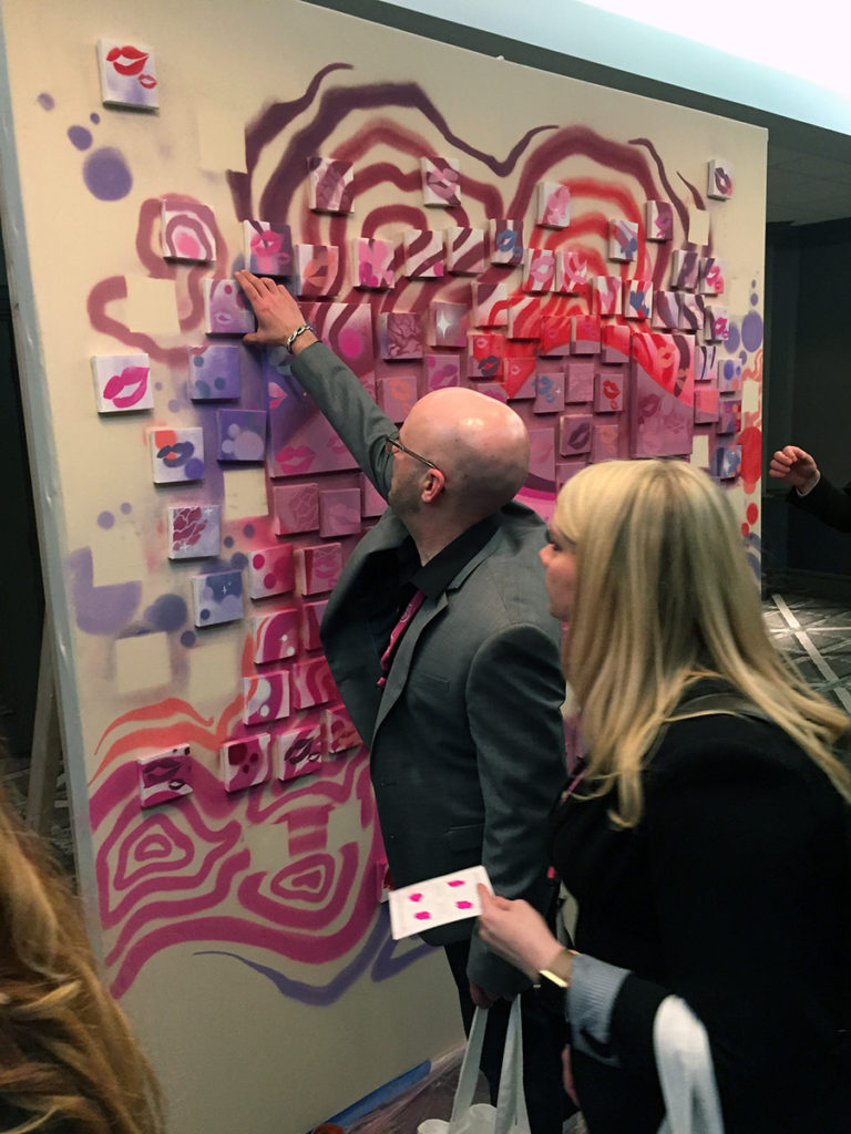 Taking Free Art from the Lip Mural wall for Bare Minerals